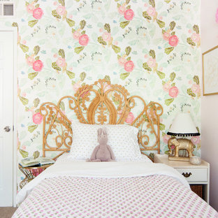 Example of an eclectic girl kids' room design in Los Angeles with multicolored walls