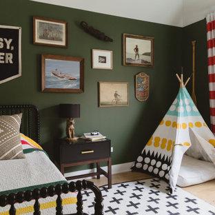 Kids' room - scandinavian light wood floor kids' room idea in Chicago with green walls