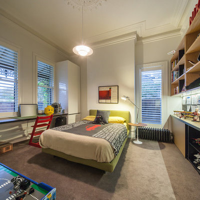Example of a trendy boy carpeted kids' bedroom design in Melbourne with white walls
