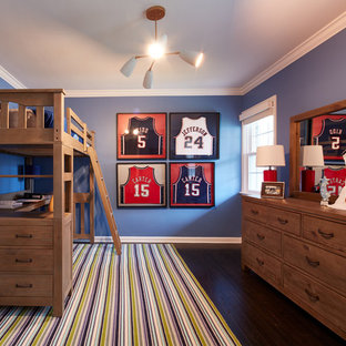 Kids' room - mid-sized traditional boy dark wood floor kids' room idea in New York with blue walls