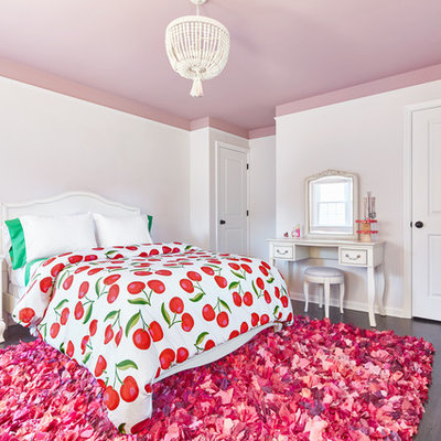 Example of a mid-sized trendy girl dark wood floor kids' room design in New York with pink walls