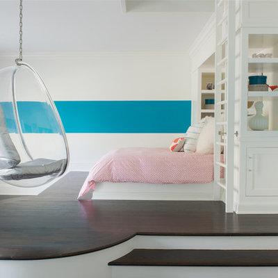 Inspiration for a large transitional girl dark wood floor and brown floor kids' room remodel in New York with multicolored walls