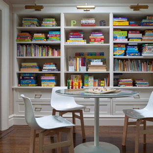 Example of a trendy kids' room design in New York with gray walls