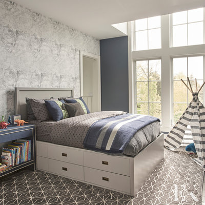 Inspiration for a mid-sized modern boy kids' room remodel in Chicago with blue walls