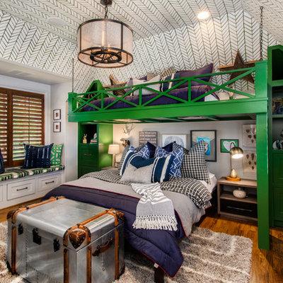 Kids' room - mid-sized traditional boy medium tone wood floor kids' room idea in Dallas with multicolored walls