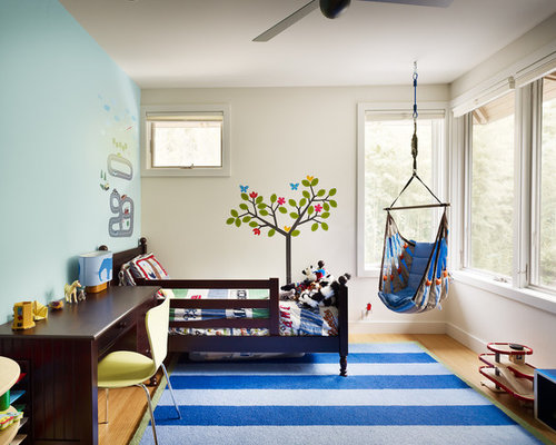 Example Of A Trendy Boy Toddler Room Design In Austin With Multicolored Walls