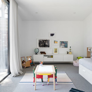 Mid-sized contemporary gender-neutral kids' playroom in Melbourne with white walls, carpet and grey floor for kids 4-10 years old.