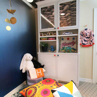 Kids' room - mid-sized shabby-chic style boy beige floor and carpeted kids' room idea in Austin with blue walls