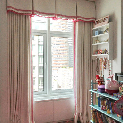 Inspiration for a small timeless girl pink floor playroom remodel in New York with beige walls