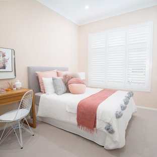 Design ideas for a contemporary kids' room for girls in Sydney with beige walls, carpet and beige floor.