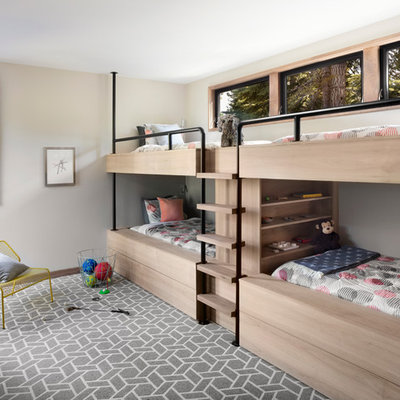 Example of a large trendy gender-neutral carpeted kids' room design in San Francisco with gray walls