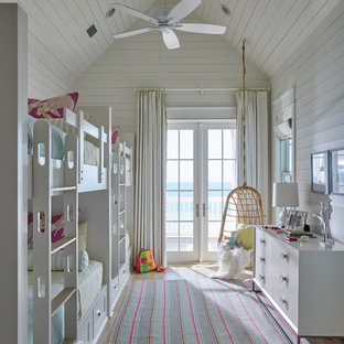 Kids' bedroom - beach style light wood floor and beige floor kids' bedroom idea in Other with white walls