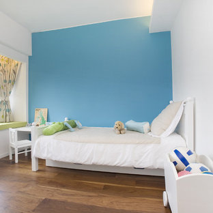 Inspiration for a contemporary kids' room in Hong Kong with blue walls.