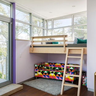Design ideas for a contemporary teen's room for girls in Boston with purple walls and dark hardwood flooring.