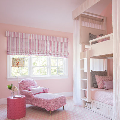Inspiration for a large transitional girl carpeted and pink floor kids' room remodel in Los Angeles with pink walls