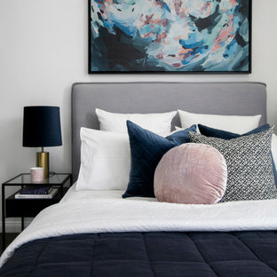 This is an example of a mid-sized contemporary kids' room for girls in Sydney with grey walls.