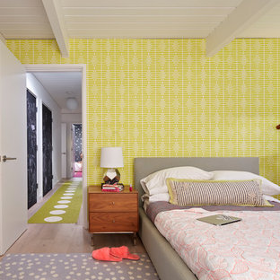 Design ideas for a midcentury kids' room for girls in San Francisco with multi-coloured walls.