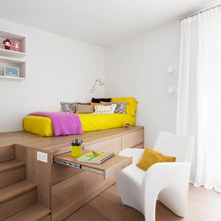 Large trendy gender-neutral medium tone wood floor kids' bedroom photo in Barcelona with white walls