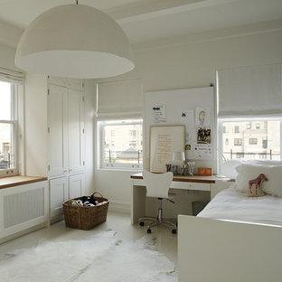 Kids' bedroom - modern gender-neutral kids' bedroom idea in New York with white walls