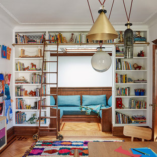 Inspiration for a large transitional gender-neutral medium tone wood floor kids' study room remodel in New York with white walls