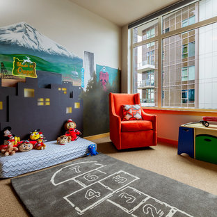 Photo of a medium sized contemporary gender neutral toddler's room in Portland with multi-coloured walls, carpet and beige floors.