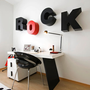 Example of a minimalist kids' study room design in Other with white walls