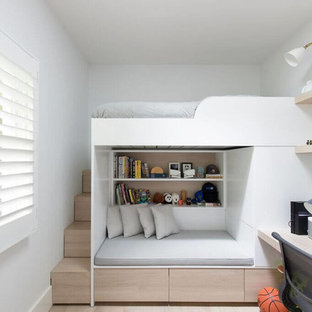 Design ideas for a contemporary gender-neutral kids' bedroom in Sydney with white walls, light hardwood floors and beige floor.