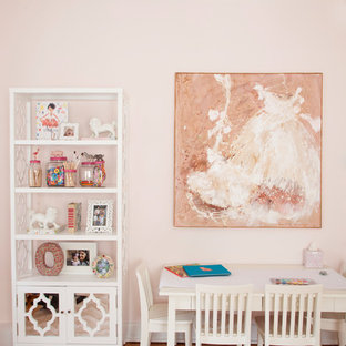 Example of an eclectic girl medium tone wood floor kids' room design in Philadelphia with pink walls