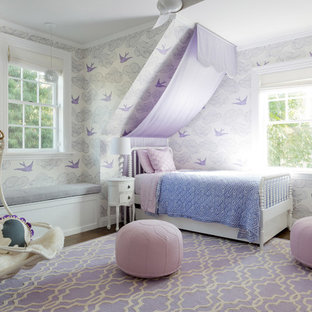 Expansive transitional kids' bedroom in Los Angeles with white walls, dark hardwood floors and brown floor for kids 4-10 years old and girls.