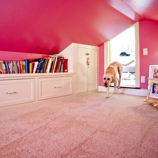This is an example of a small traditional kids' playroom for kids 4-10 years old and girls in Louisville with pink walls and carpet.