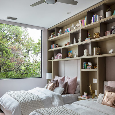 Inspiration for a contemporary girl kids' room remodel in Austin with white walls