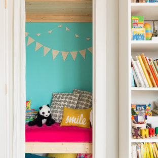 Photo of a small eclectic children's room for girls in Vancouver with blue walls.