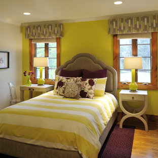 Inspiration for a transitional girl medium tone wood floor kids' room remodel in Nashville with yellow walls