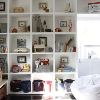 Kids' room - mid-sized transitional gender-neutral dark wood floor kids' room idea in Los Angeles with white walls