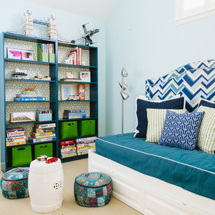 Trendy boy carpeted playroom photo in San Francisco with blue walls
