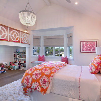 Inspiration for a timeless girl medium tone wood floor kids' bedroom remodel in Orange County with white walls