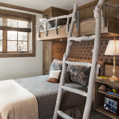 Inspiration for a rustic gender-neutral carpeted kids' bedroom remodel in Denver with white walls