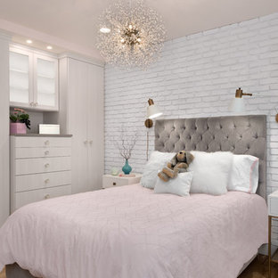 Example of a small trendy girl light wood floor and brown floor kids' room design in Seattle with pink walls