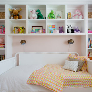 Kids' room - mid-sized traditional girl kids' room idea in Los Angeles with pink walls