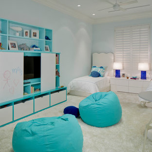 Large transitional girl carpeted kids' room photo in Miami with blue walls