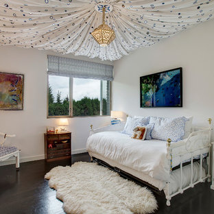 Example of a trendy girl dark wood floor kids' room design in Seattle with white walls