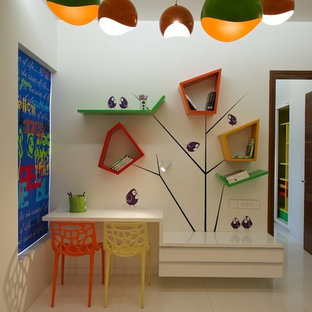 Inspiration for a contemporary gender-neutral kids' room remodel in Ahmedabad with white walls