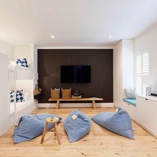 Design ideas for a beach style gender-neutral kids' bedroom for kids 4-10 years old in Melbourne with white walls, light hardwood floors and brown floor.
