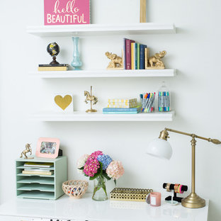 Kids' room - mid-sized modern girl carpeted kids' room idea in Charlotte with white walls