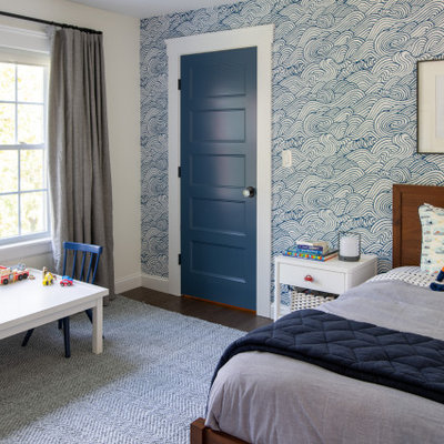 Example of a mid-sized eclectic boy dark wood floor kids' room design in Boston with white walls