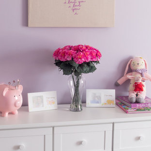 Purple and Pink Girl's Bedroom with White Furniture