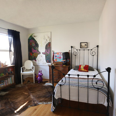 Inspiration for an eclectic gender-neutral medium tone wood floor kids' room remodel in San Diego with white walls
