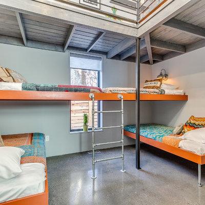 Kids' bedroom - contemporary gender-neutral concrete floor and gray floor kids' bedroom idea in Oklahoma City with gray walls