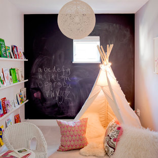 Kids' room - small eclectic gender-neutral carpeted kids' room idea in Vancouver with multicolored walls