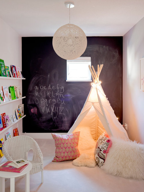 Playroom small eclectic gender neutral carpeted playroom idea in vancouver with multicolored walls
